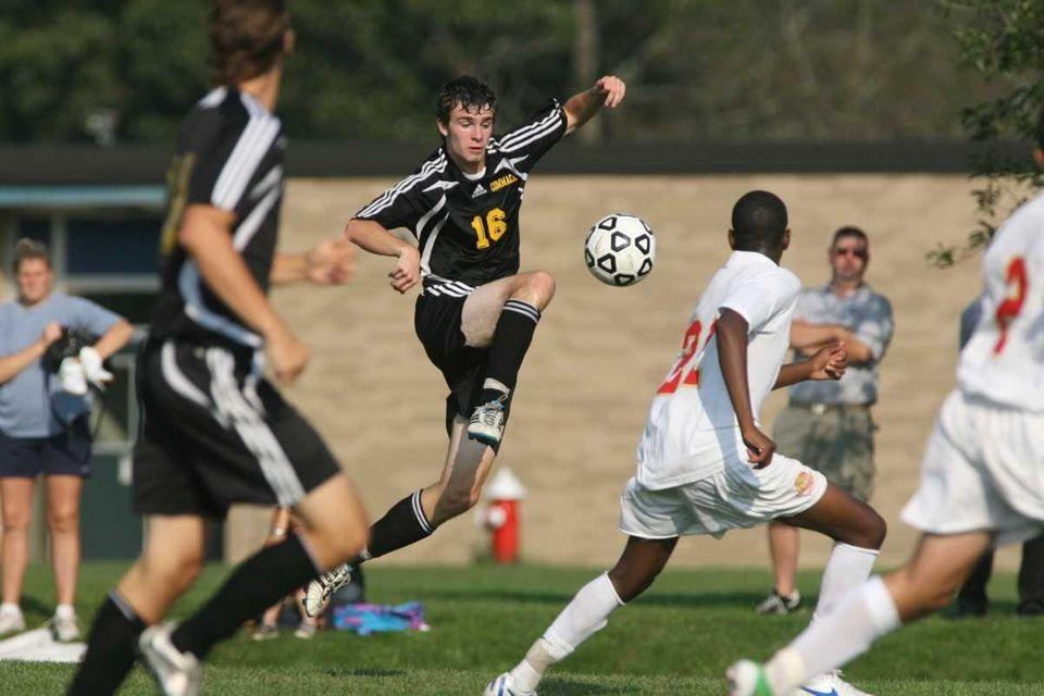 Commack's Jake foley moves the ball. (Sept. 12,