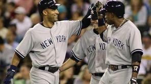 New York Yankees' Derek Jeter, left, greets Yankees'