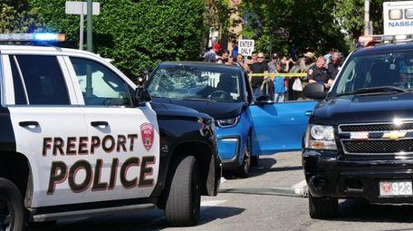 Freeport police investigate Monday at the crash scene