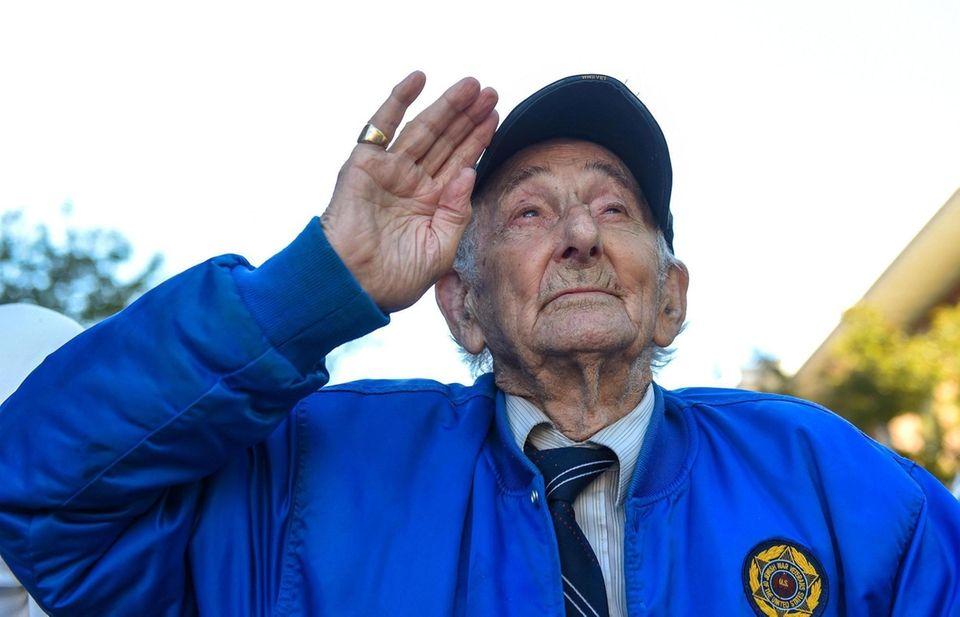 WWII veteran Morris Koffer, 96, of Melville, salutes