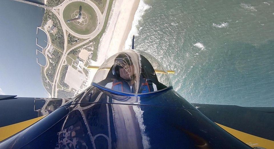 Aerobatic pilot David Windmiller flies over Long Island's
