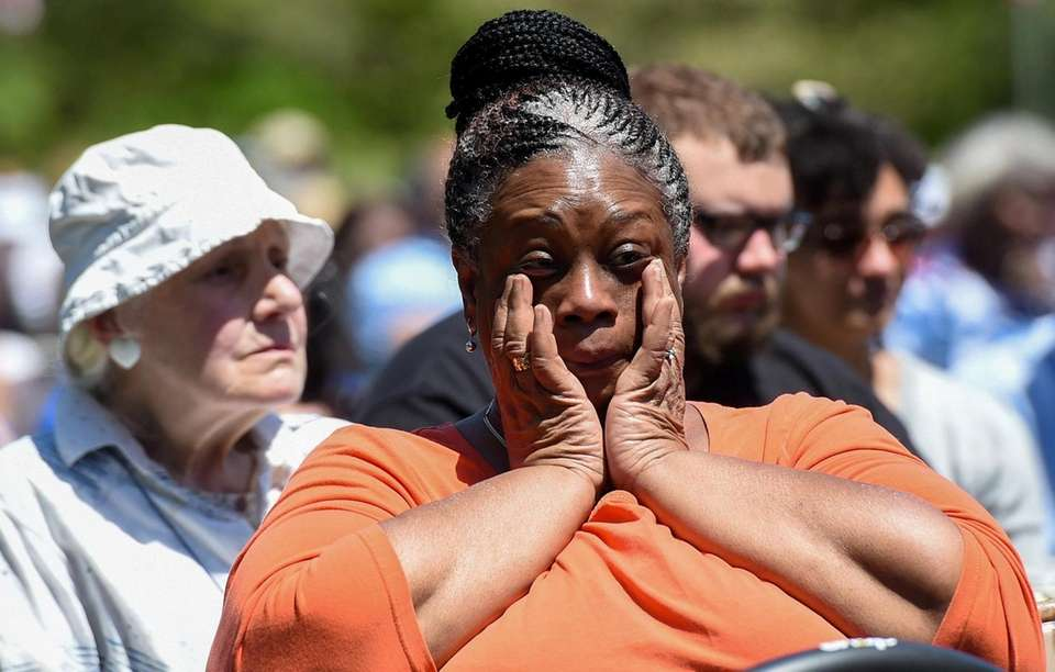A woman becomes emotional during a Memorial Day