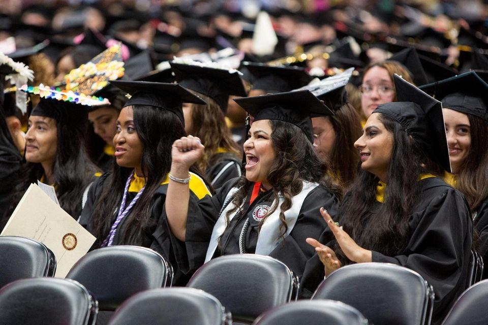 Graduates react as Molloy College President Drew Bogner