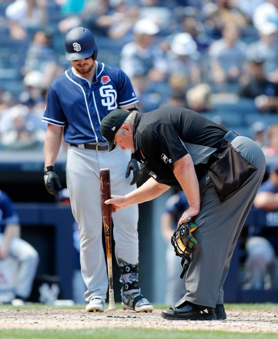 Home plate umpire Joe West works on the