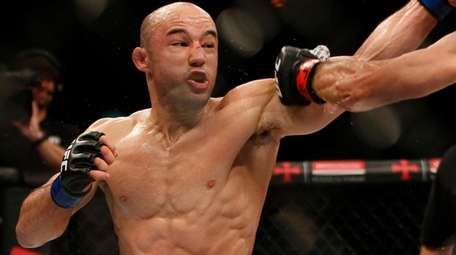 Marlon Moraes, left, and Raphael Assuncao fight in