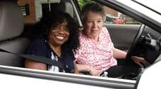 Michelle Murray, left, is picked up from her