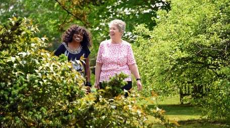 Michelle Murray, left, and Judy Delaney stroll in