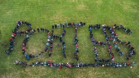 Greenport Elementary School students and staff form the