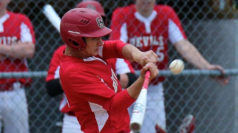 Center Moriches Alec Maag drills an RBI double