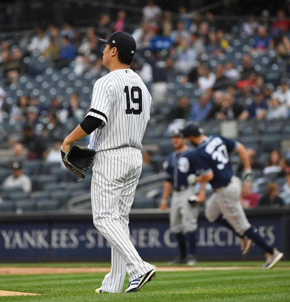 New York Yankees starting pitcher Masahiro Tanaka watches