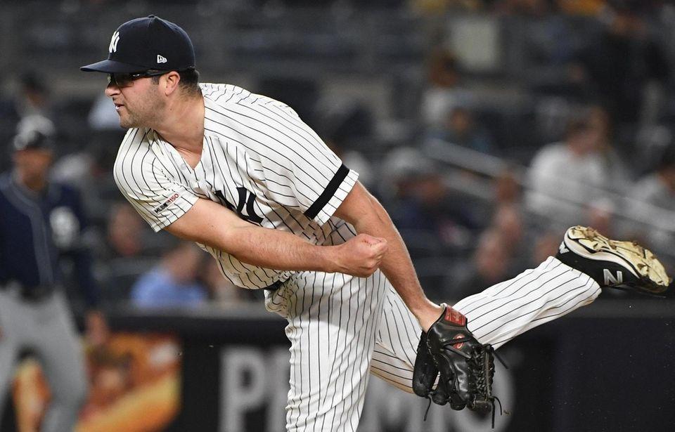 New York Yankees relief pitcher Joe Harvey delivers