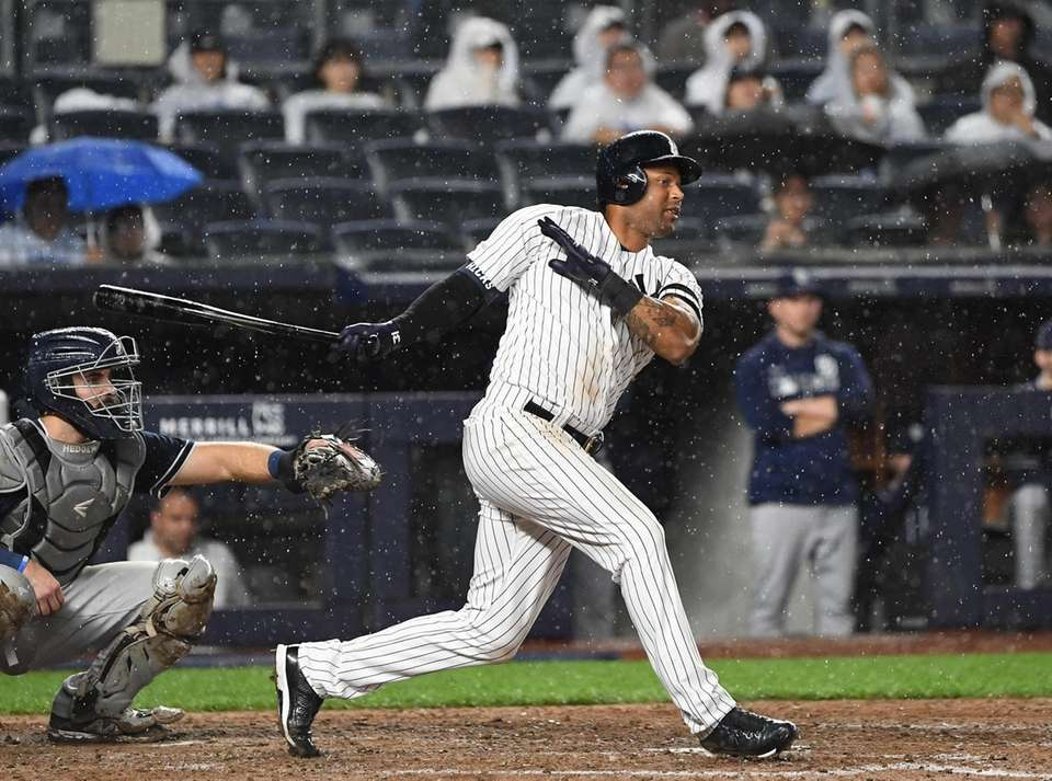 New York Yankees center fielder Aaron Hicks connects