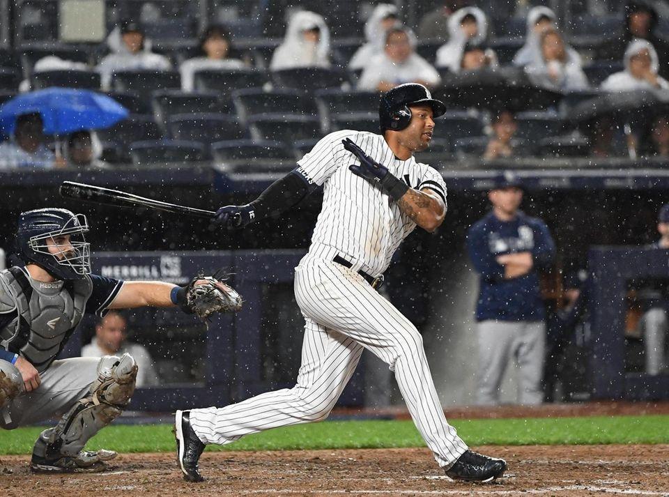 New York Yankees center fielder Aaron Hicks connects