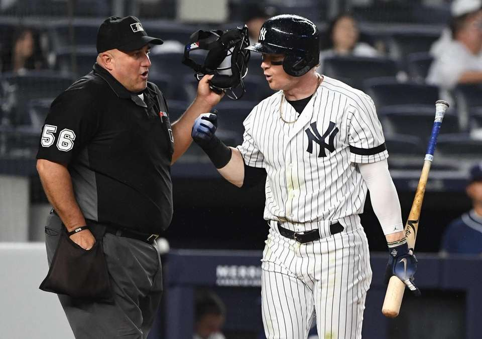 New York Yankees right fielder Clint Frazier argues