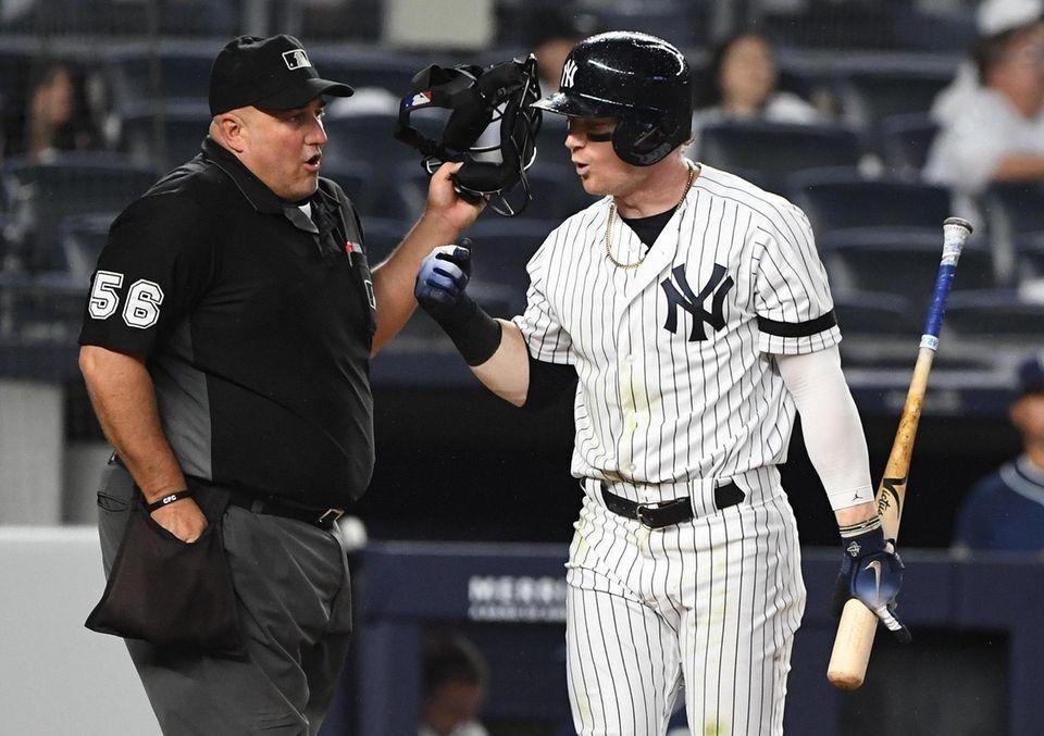 New York Yankees right fielder Clint Frazier argues