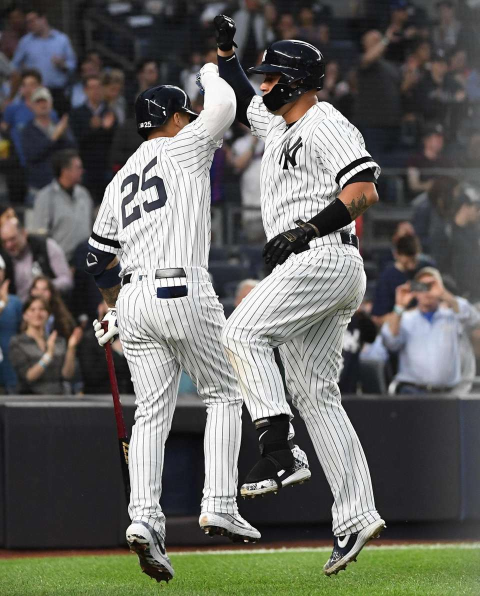 New York Yankees' Gleyber Torres greets Gary Sanchez