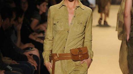 A model walks the runway at the Michael