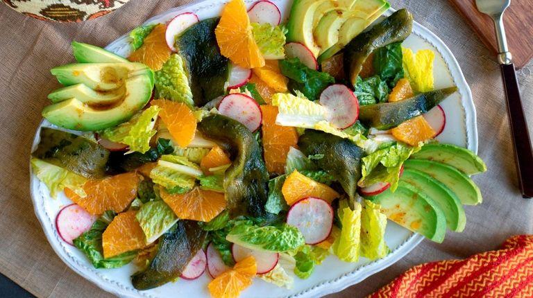 Bright orange slices, roasted chiles, romaine, radishes and