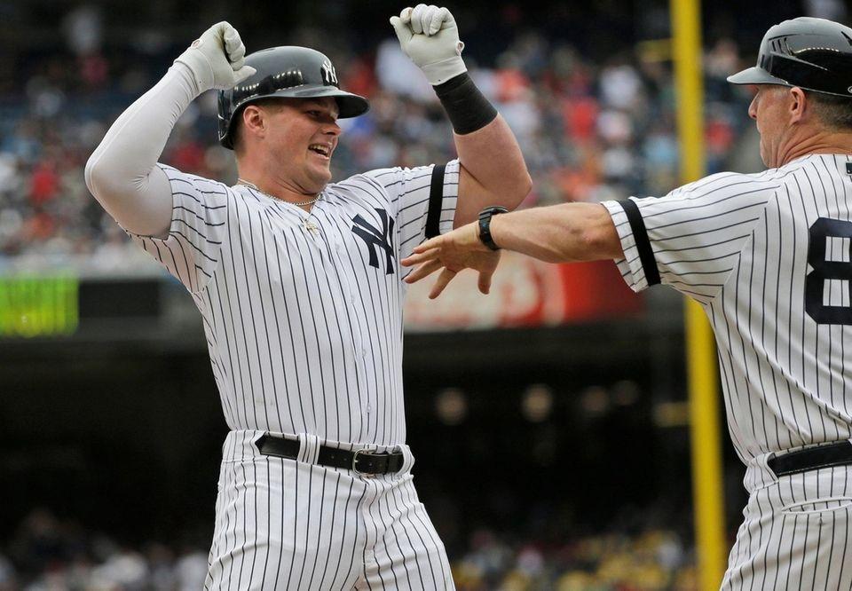 Luke Voit celebrates his home run in the