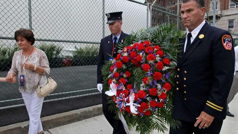 FDNY Deputy Chief Jimmy Riches, right, who lost