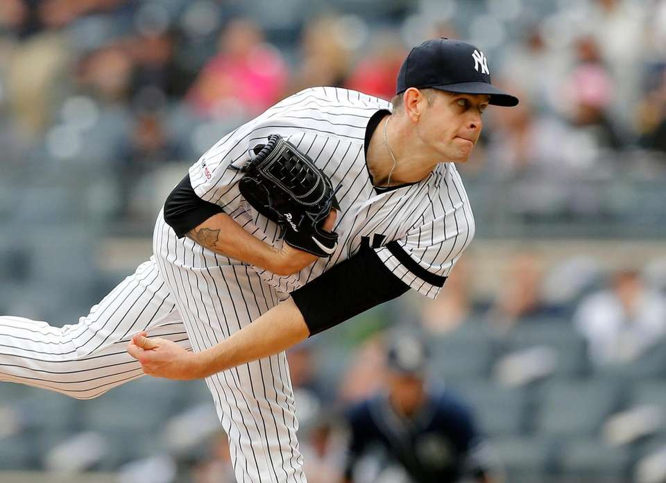 Yankees pitcher James Paxton delivers during the first
