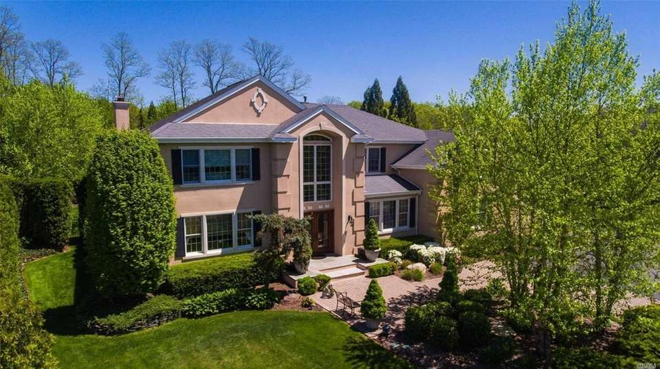 This Woodbury Colonial includes six bedrooms and 4