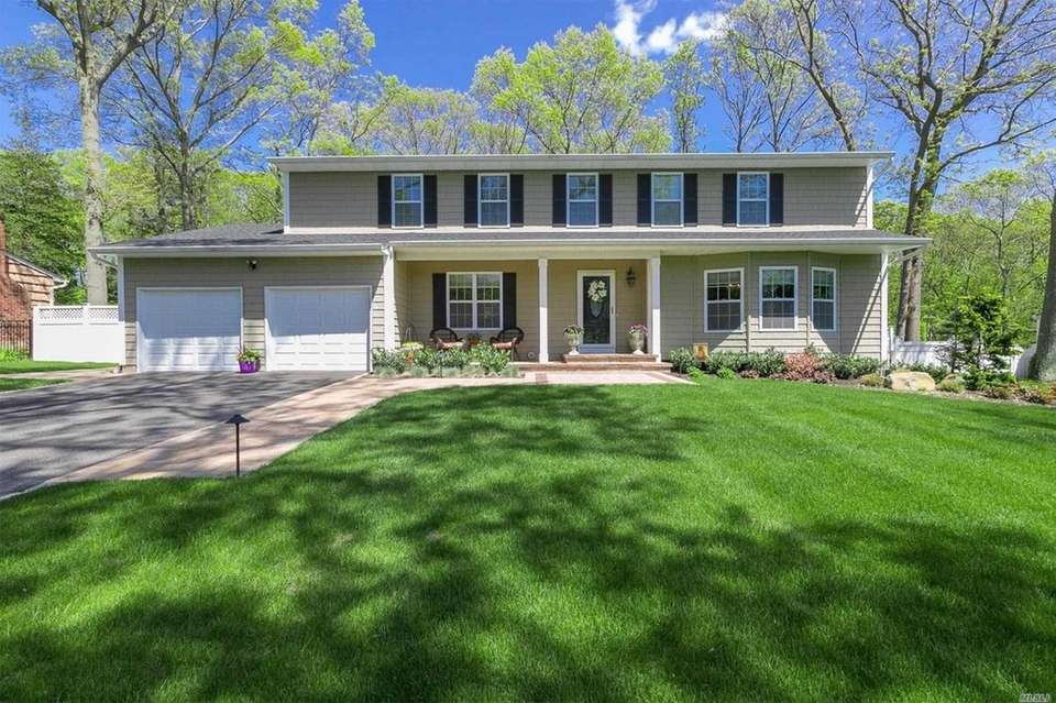 This Smithtown Colonial includes five bedrooms and 3