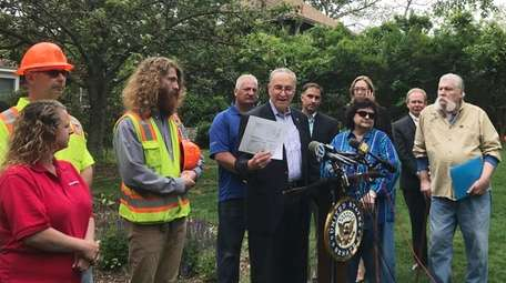 In Patchogue Wednesday, Sen. Chuck Schumer holds up