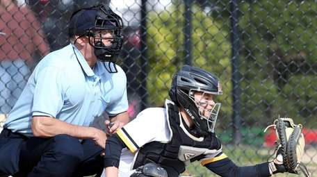 Softball Umpire Tom Cully calls a game at