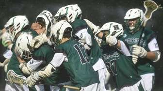 Harborfields teammates celebrate after their county championship-clinching 11-6
