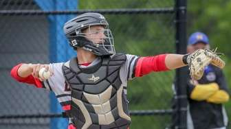 Alex Maag #6 of Center Moriches throws to