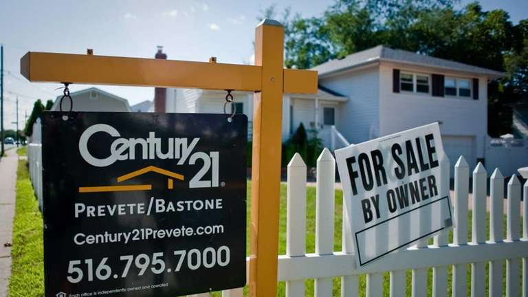 Century 21's house-for-sale sign hangs in front of