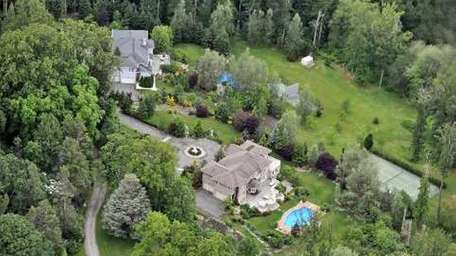 Two adjoining seven-acre Lattingtown properties, each featuring its