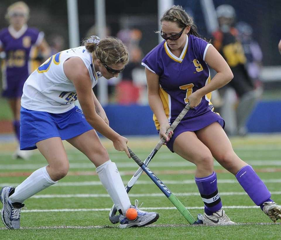 Sayville's Olivia Cabral battles for possession with West