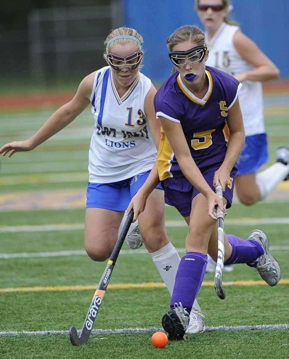 Sayville's Taylor Mills battles for possession with a