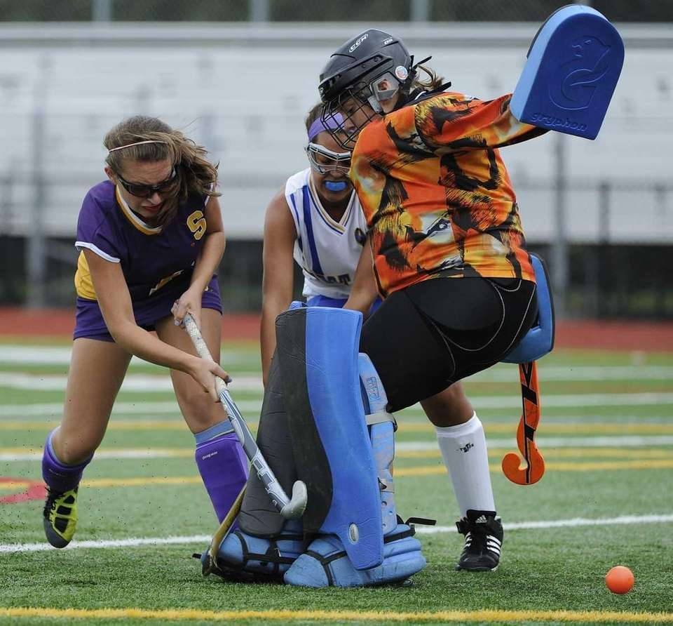 Sayville's Julianna Fiorillo gets the ball past West