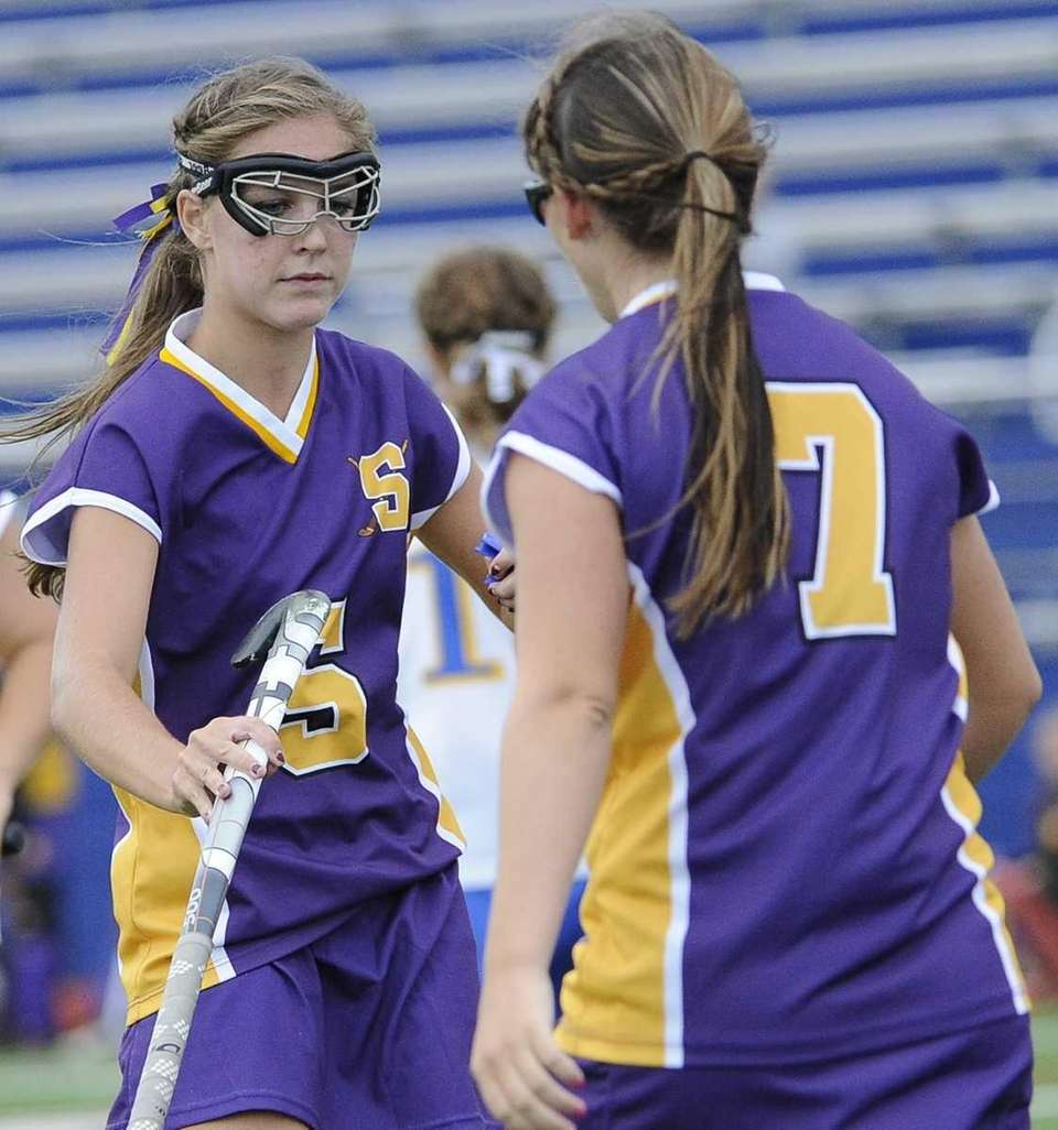 Sayville's Taylor Mills, left, and Olivia Cabral, right,