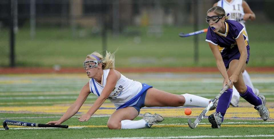 West Islip's Brittany Hoffman loses her footing against