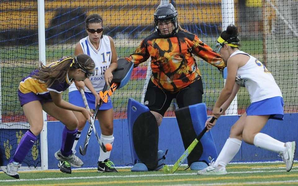 Sayville's Taylor Mills takes a shot on West