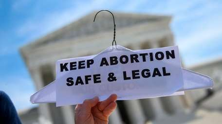 Abortion rights activists rally in front of the