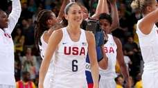 Team USA's Sue Bird celebrates after winning the