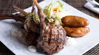 Grilled lamb chops arrive with crisp fingerling potatoes,
