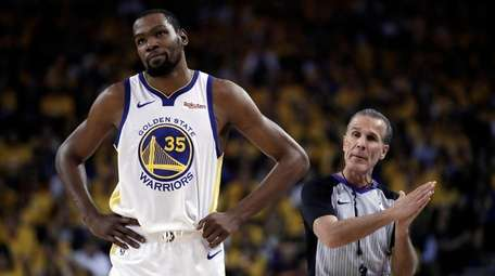 Kevin Durant of the Warriors walks away from