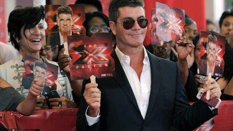 Simon Cowell, executive producer and a judge on