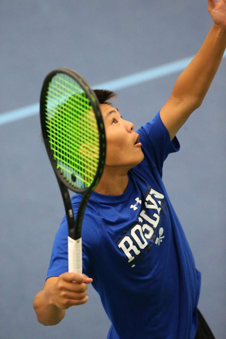 Roslyn's Adrian Tsui serves as he and teammate