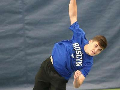 Roslyn's Mikey Weitz serves as he and teammate