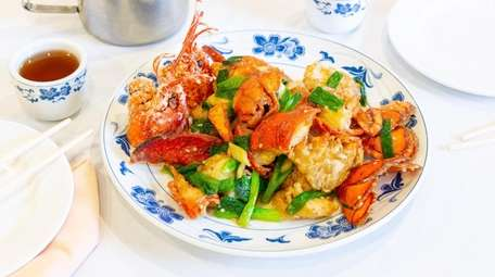 Lobster stir fried with ginger and scallions is