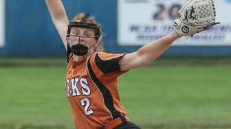 Emily Chelius of East Rockaway pitches on her