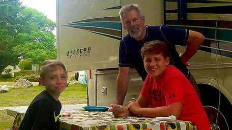 Dennis Orioles with his grandsons Austin, left, and