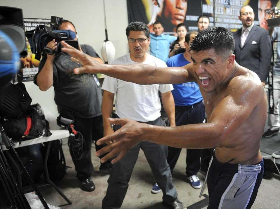 Victor Ortiz throws a medicine ball at the